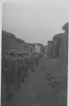 Troops Marching Through A Village